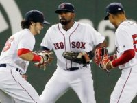 Boston Red Sox's Andrew Benintendi (16), Jackie Bradley Jr., center, and Mookie Betts (50) celebrate after defeating the Baltimore Orioles 5-2 in a baseball game, Tuesday, May 2, 2017, in Boston. (AP Photo/Michael Dwyer)